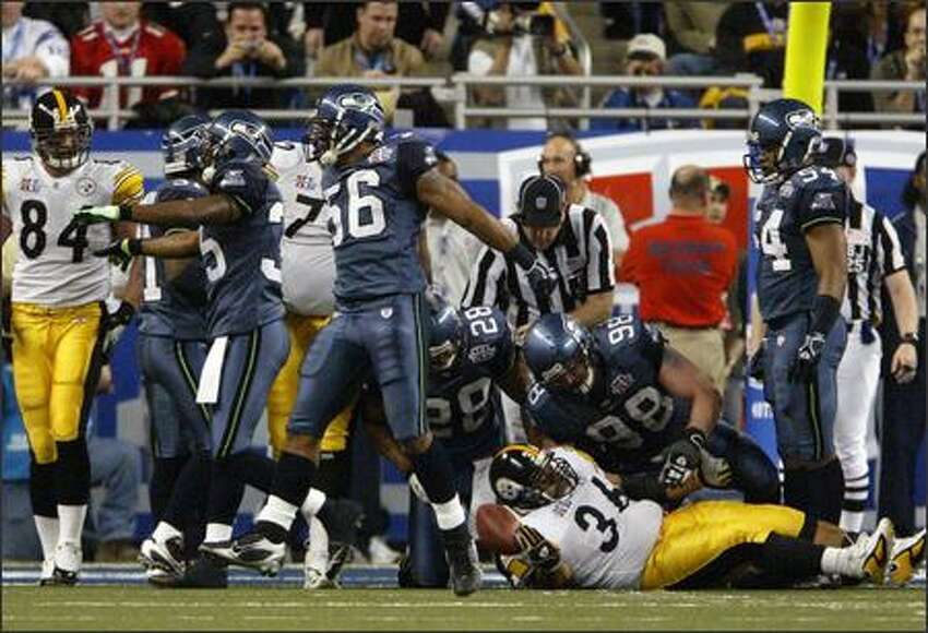 Jerome Bettis (36) is stopped at the Seattle 1 for no gain by Seattle's Leroy Hill (56) while teammates celebrate.