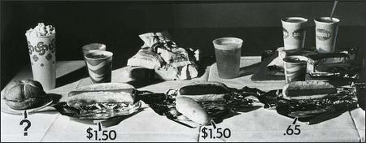 Regular hot dogs were 65 cents during the Mariners' 1977 inaugural season. King Dogs were $1.50, as were the New Orleans Hot Links. Olympian beer was on tap. (Grant M. Haller, P-I/1976)