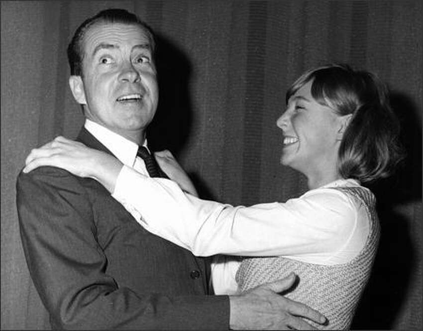 Richard Nixon with an admirer in 1966.