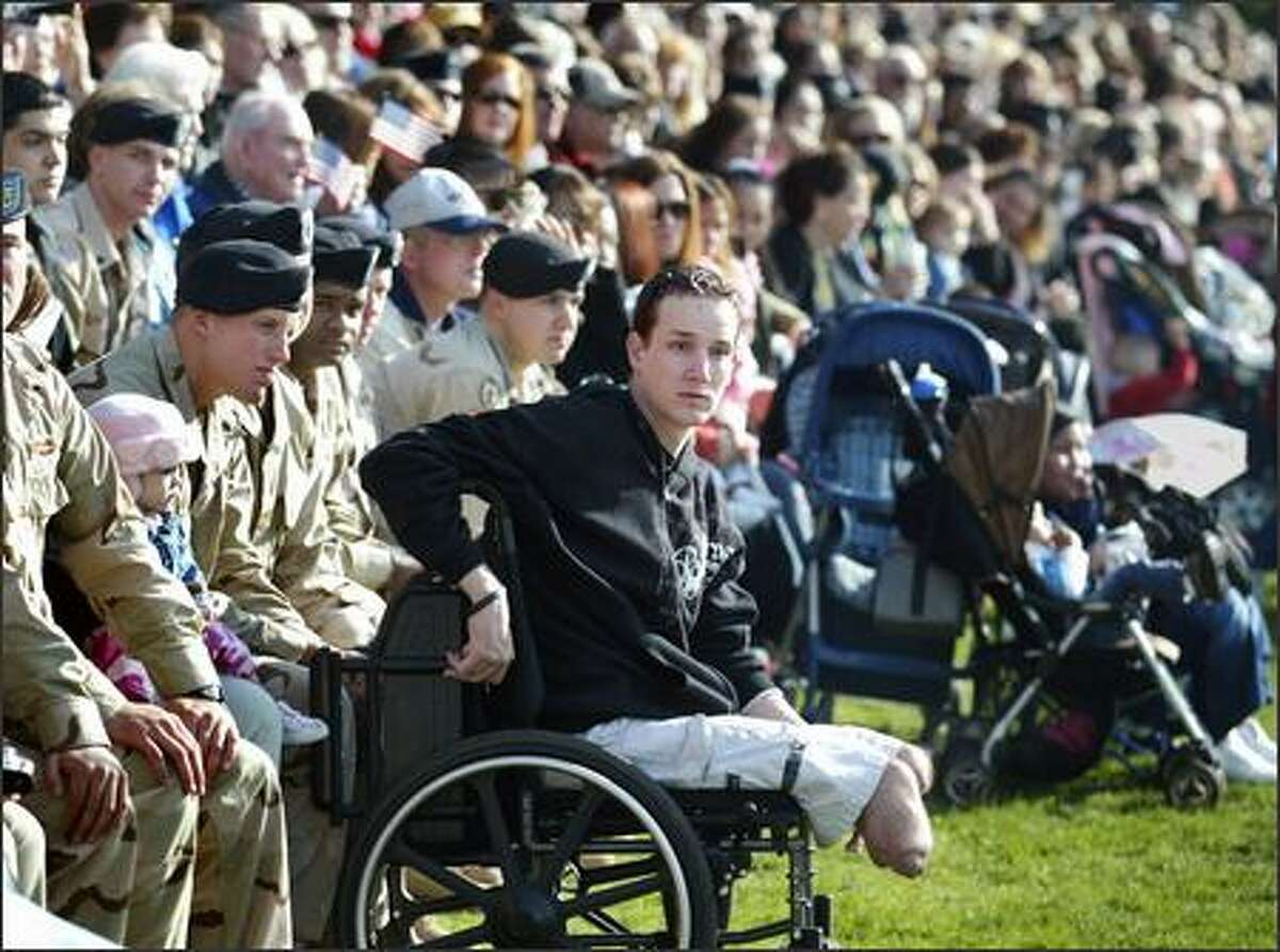 Sgt. Brent Bretz watches the festivities. December 2004, the month Bretz was wounded, was one of the worst of the brigade's deployment, with 10 soldiers killed, including six blow up by a suicide bomber in a mess tent near Mosul on Dec. 21.