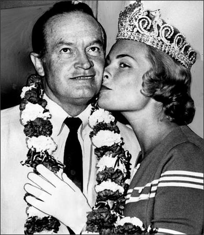 After the 1962 World's Fair put Seattle on the map, celebrities doing shows here often took part in Seafair. In 1963, Bob Hope was bussed by Seafair Queen Arlene Hinderlie and served as honorary grand marshal for the Torchlight Parade. Photo: Phil H. Webber, Seattle Post-Intelligencer