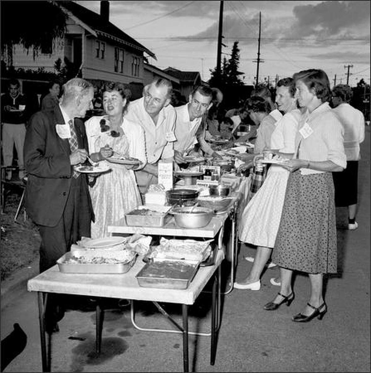 A neighborhood street party in August 1959.