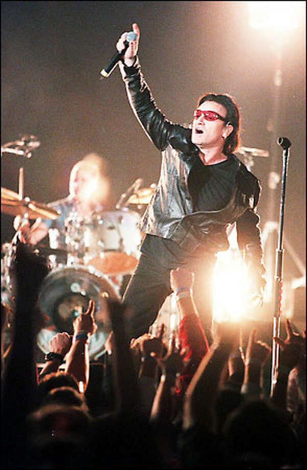 "U2's lead singer Bono plays to the crowd at the Tacoma Dome stop of the Irish super band's ""Elevation"" tour. Photo: Paul Joseph Brown, Seattle Post-Intelligencer"