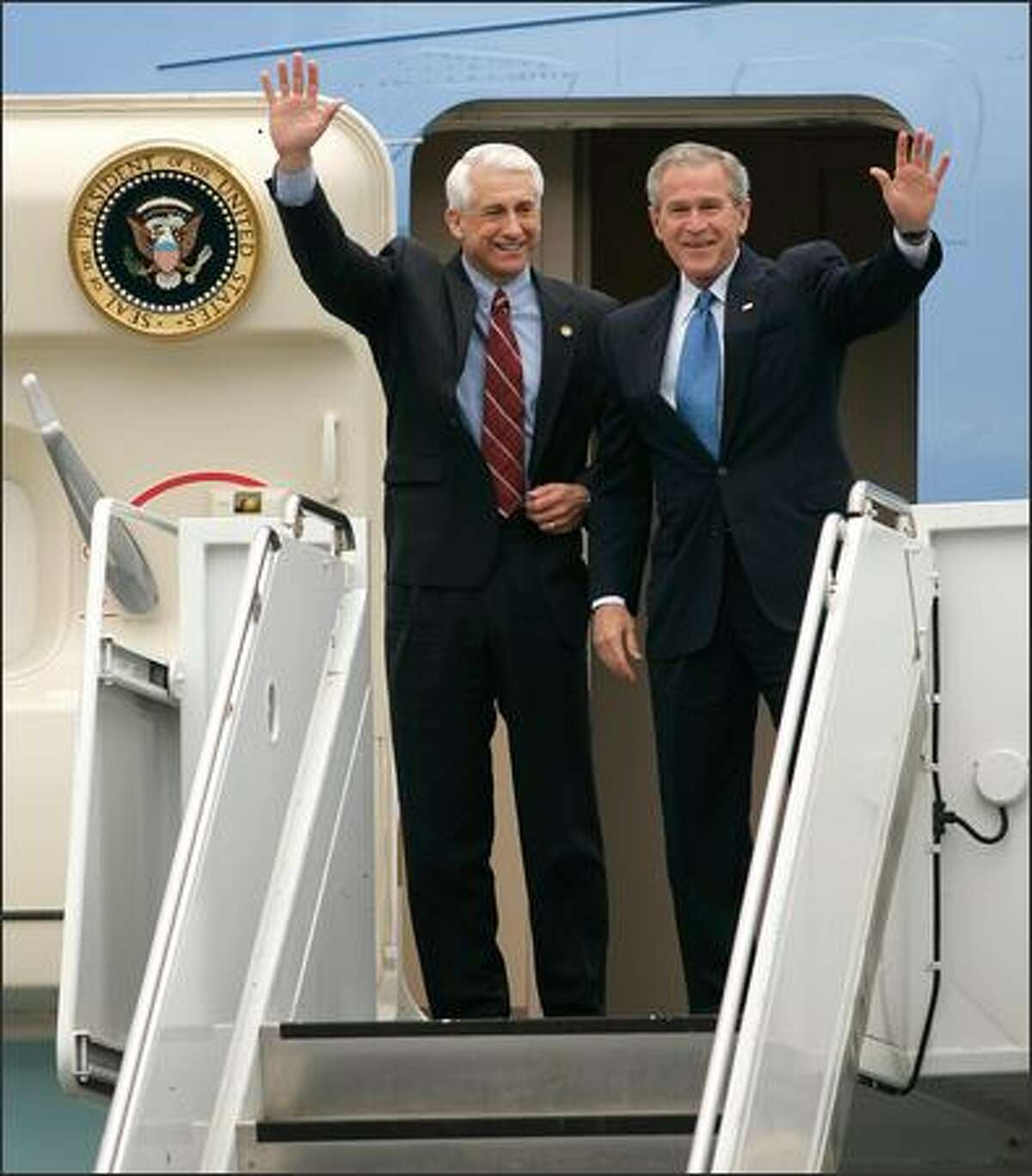 President Bush greets the crowd as he emerges from Air Force One with Rep. Dave Reichert.