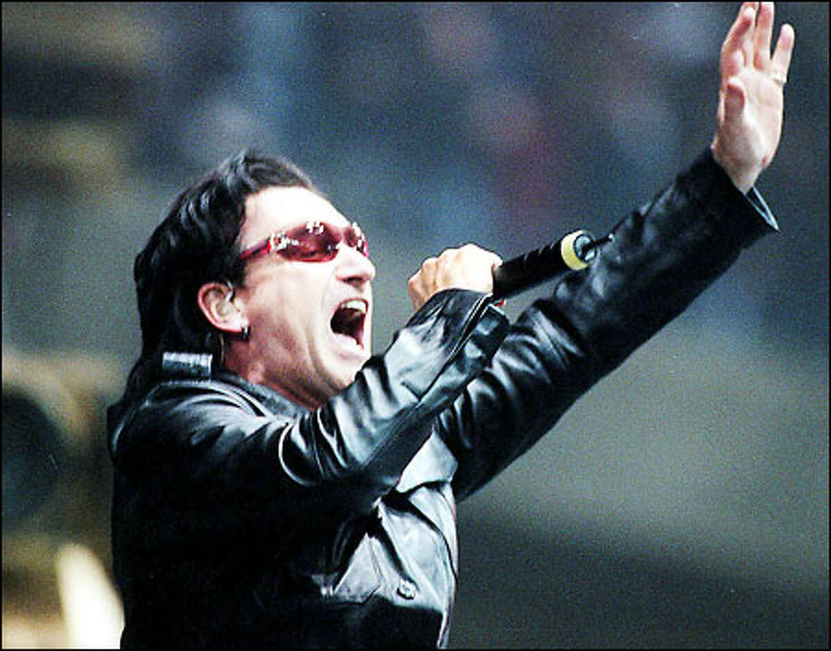 U2's frontman Bono belts out
