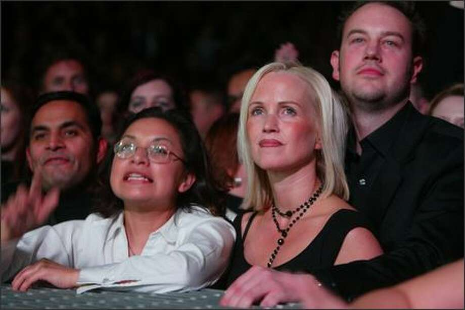 "Fans listen to ""A Question of Time"" by Depeche Mode. Photo: Grant M. Haller, Seattle Post-Intelligencer"