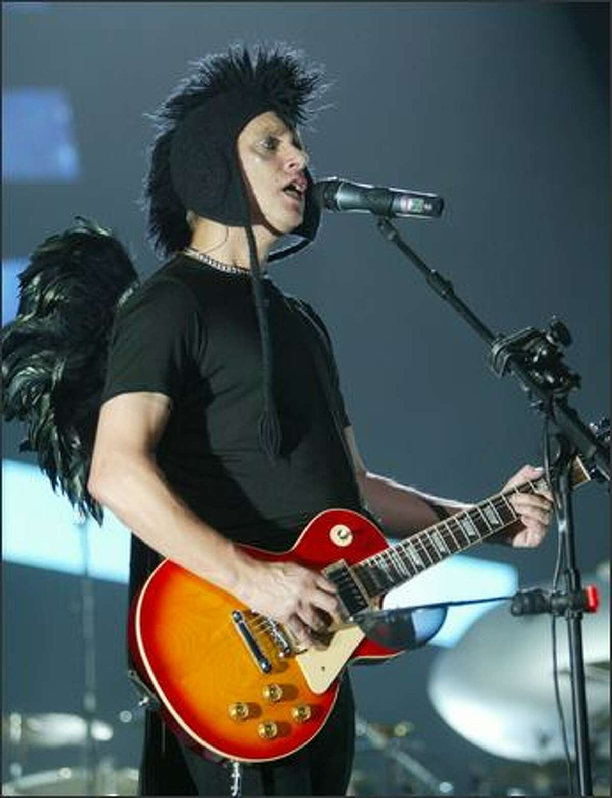 Depeche Mode's Martin Gore, on guitar, sings