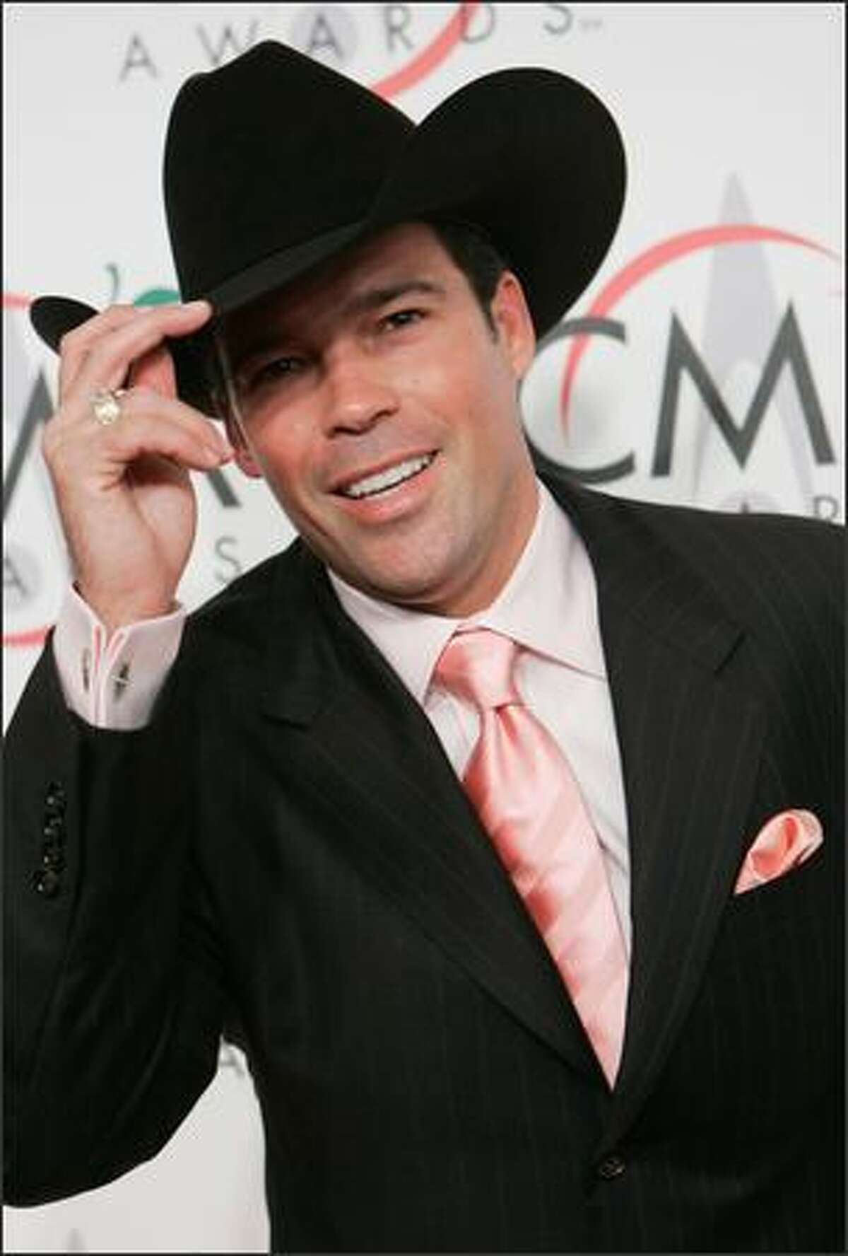 Country singer Clay Walker arrives for the 39th Annual Country Music Association Awards in New York. (AP Photo/Stuart Ramson)