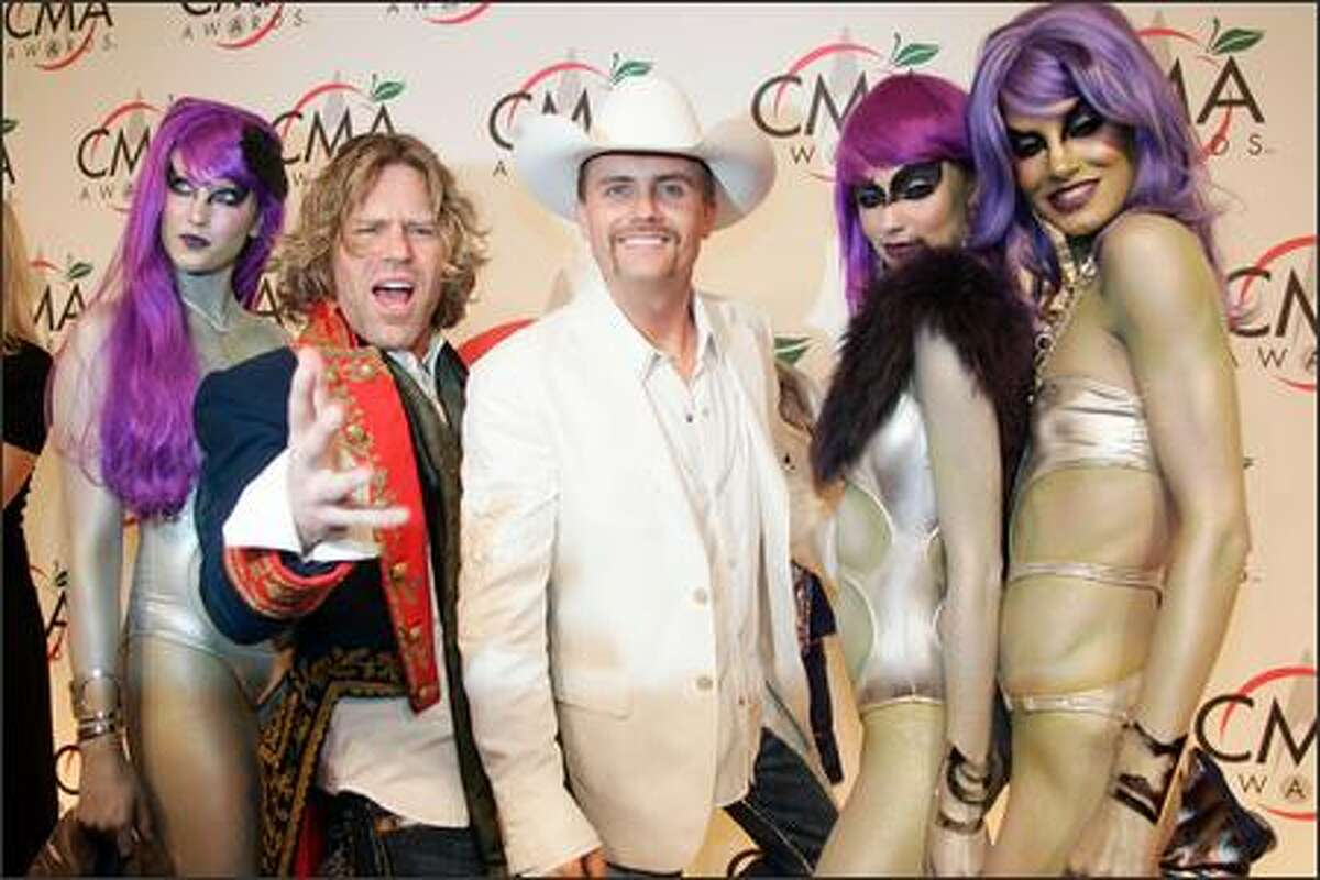 John Rich, third from right, and Big Kenny, second from left, of the duo Big & Rich, nominated for the Horizon Award and vocal duo of the year, arrive for the 39th Annual Country Music Association Awards in New York. (AP Photo/Peter Morgan)