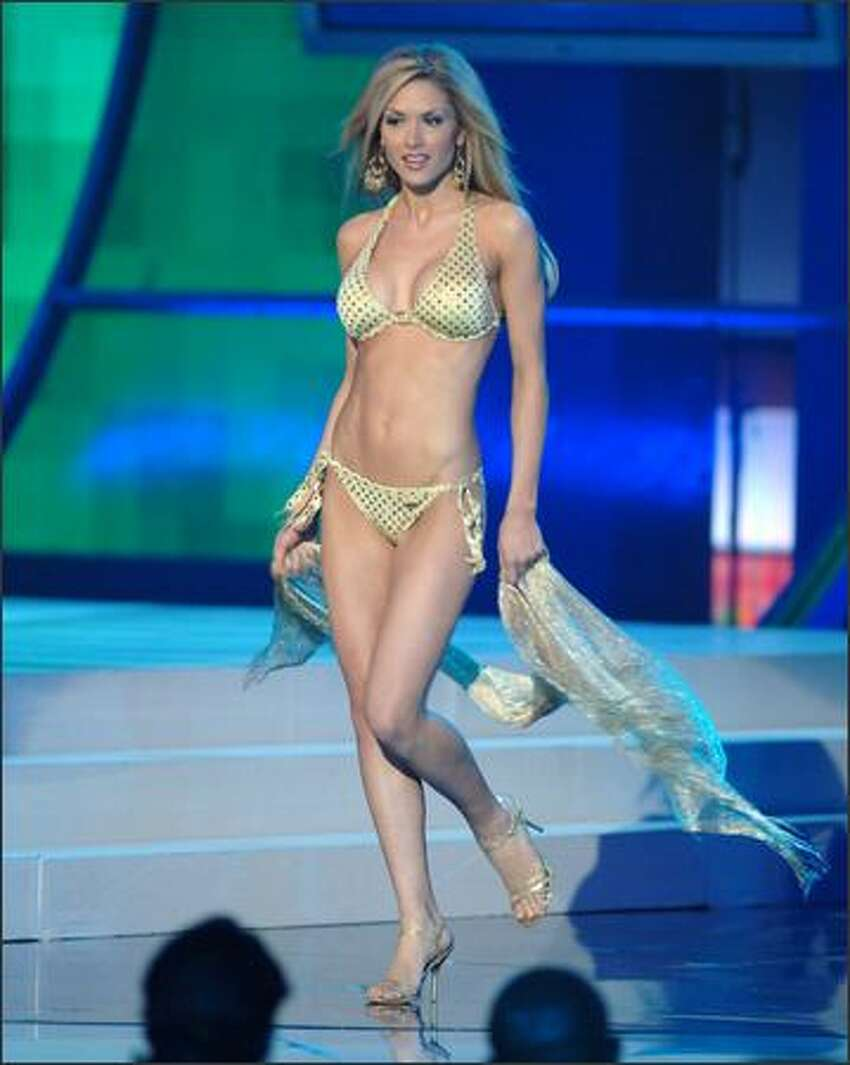 Wearing a swimsuit from BSC Swimwear Thailand and Steve Madden shoes, Tara Elizabeth Conner, Miss Kentucky, participates in the swimsuit portion of the Miss USA competition at the 1st Mariner Arena in Baltimore.