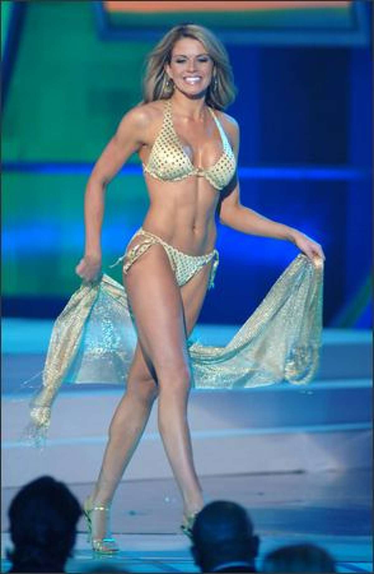 Wearing a swimsuit from BSC Swimwear Thailand and Steve Madden shoes, Leeann Tingley, Miss Rhode Island USA 2006, participates in the swimsuit portion of the Miss USA competition at the 1st Mariner Arena in Baltimore.