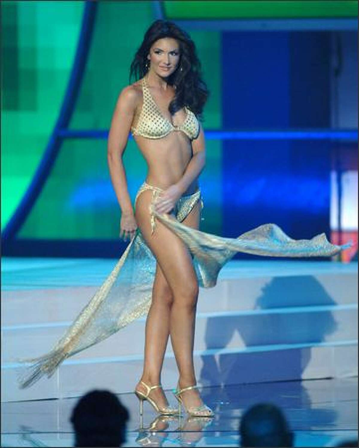 Wearing a swimsuit from BSC Swimwear Thailand and Steve Madden shoes, Lauren Lanning, Miss Texas USA 2006, participates in the swimsuit portion of the Miss USA competition at the 1st Mariner Arena in Baltimore.