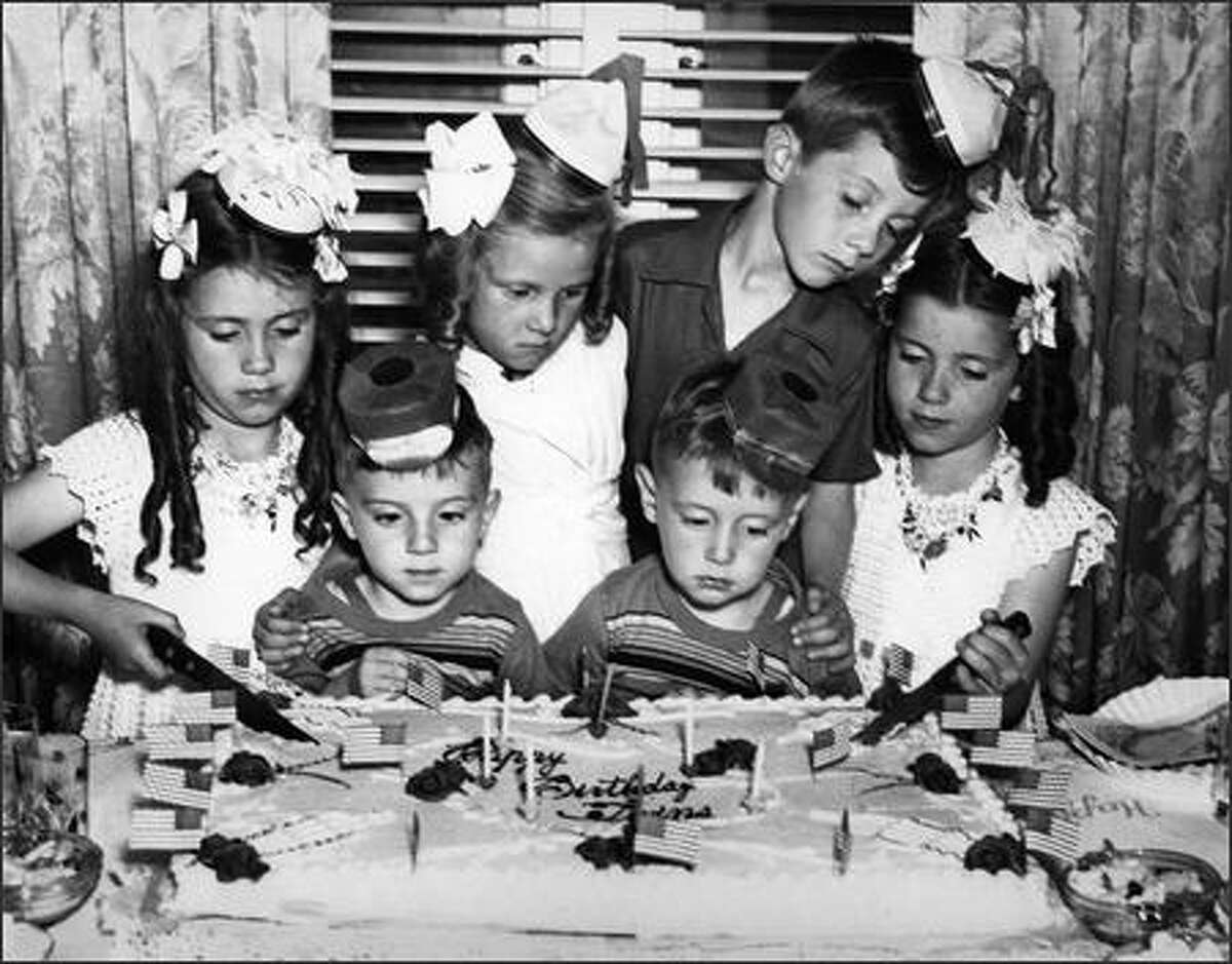 Phil Webber wondered if his career choice might have been inspired at an early age when a P-I photographer snapped this photo of a joint birthday party for three sets of twins. In front are Phil, on the right, and his twin brother, Bill; they were 3.