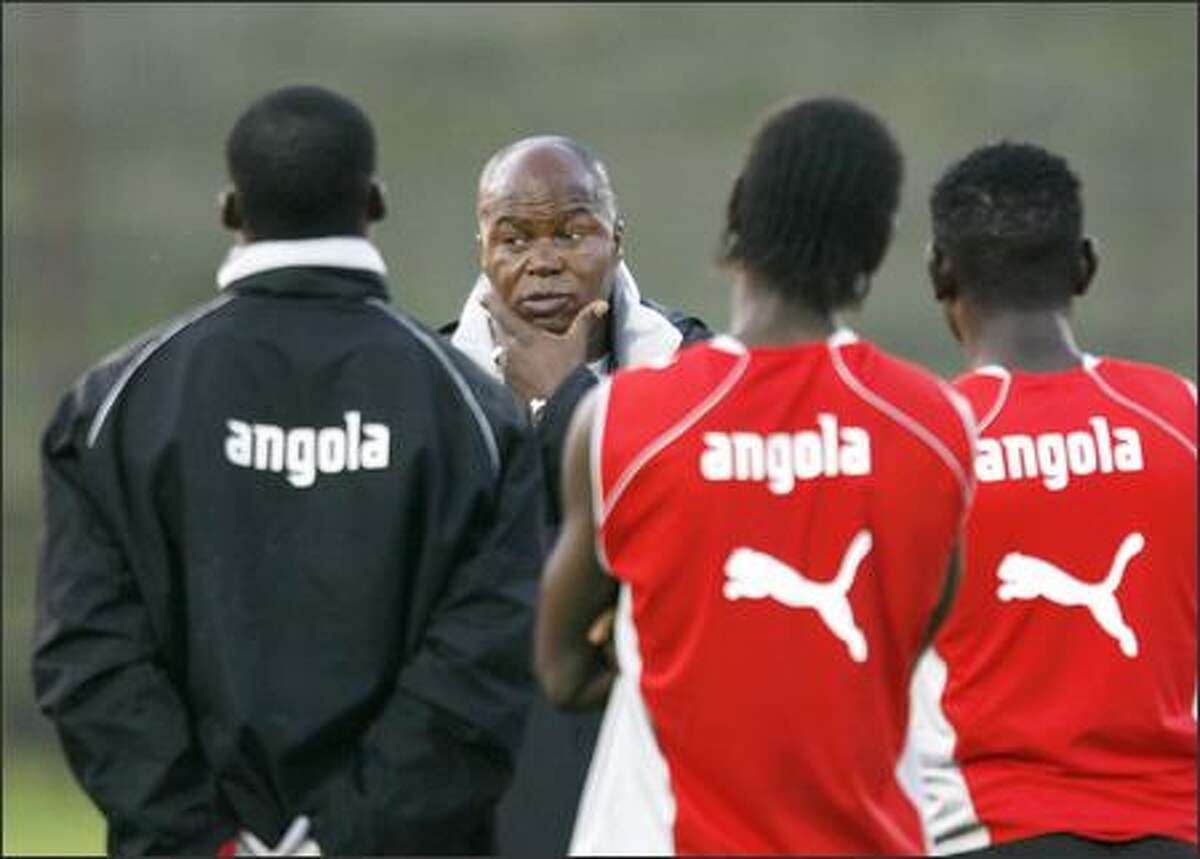 Angola coach Luis Oliveira Goncalves speaks with team players during practice in Celle, northern Germany, Thursday. Angola will start in the World Cup with a match against Portugal in Cologne, on Sunday. Angola will face the teams of Portugal, Mexico and Iran in the group D at the World Cup 2006. (AP Photo/Luca Bruno)