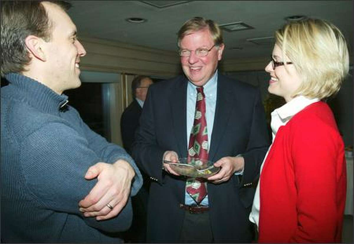 Mayoral candidate Al Runte enjoys a laugh with Kevin Price, left, and Sarah Barry, right, at an election night party.