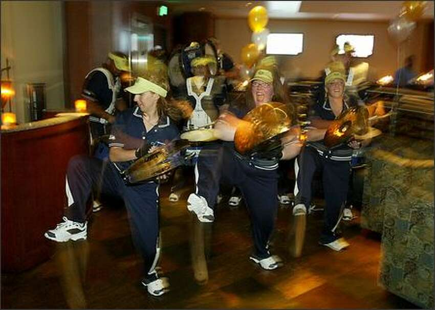 The Seahawks' Blue Thunder band stomps, clangs and bangs its way through the Fox Sports Grill during the FSN Stars Night Out.