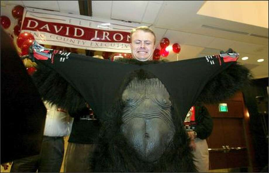 Initative king Tim Eyman wears a gorilla suit in support of Initative 900 and tears it off in front of supporters at the Doubletree Hotel in Bellevue. Photo: Scott Eklund, Seattle Post-Intelligencer