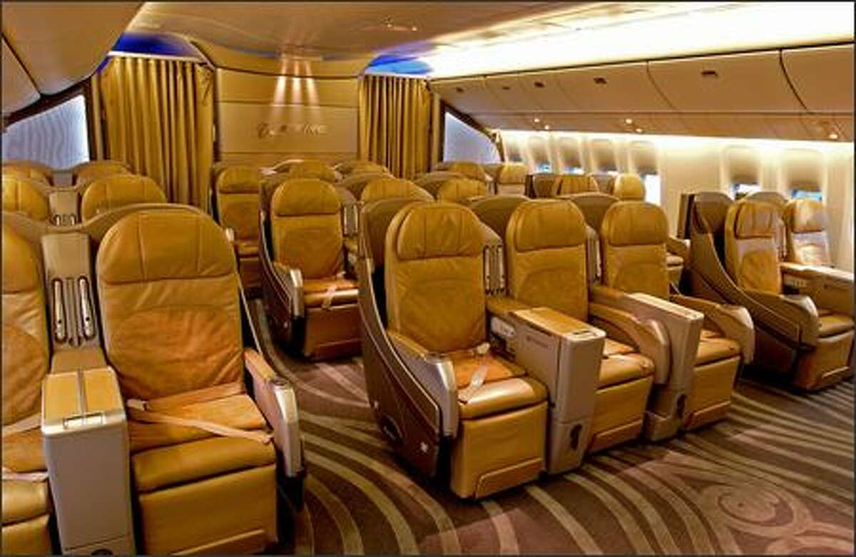 Business-class seating aboard the Boeing 777-200LR. The passenger cabin uses light-emitting diodes can easily be adjusted during flight, creating a light blue sky during the day, for example, or a night sky with what look like stars to make it easier to sleep.