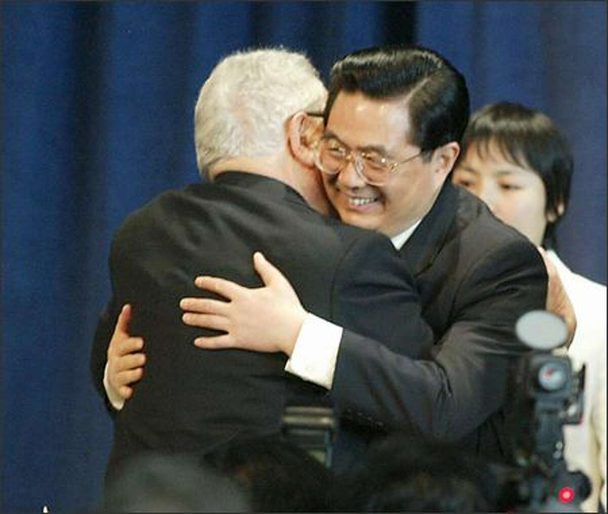 Chinese President Hu Jintao greets former Secretary of State Henry Kissenger with a hug upon his arrival at the Friendship Luncheon held at Future of Flight in Mukilteo.