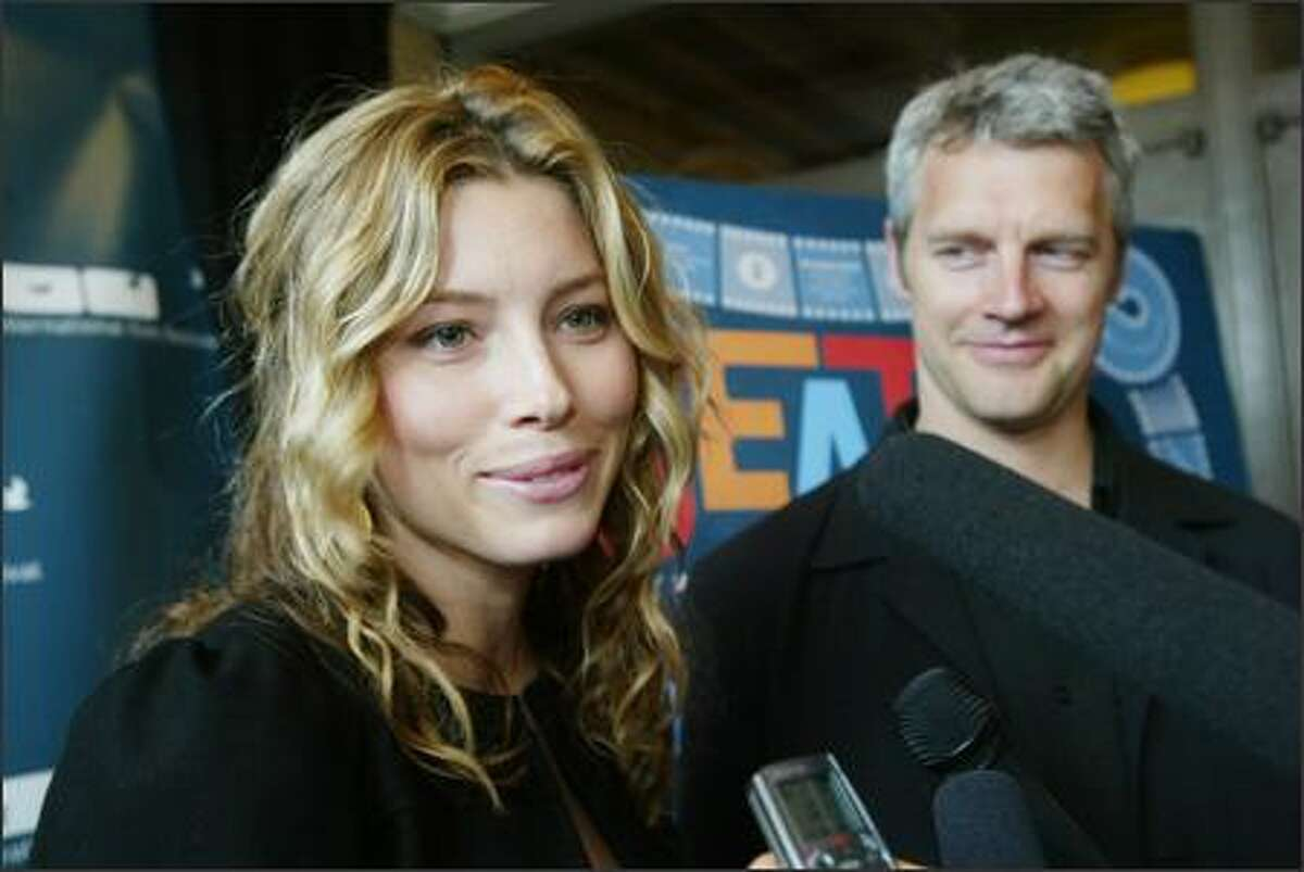 Actress Jessica Biel and director Neil Burger answer questions from the media on the red carpet at the Seattle International Film Festival's opening night premiere of their film