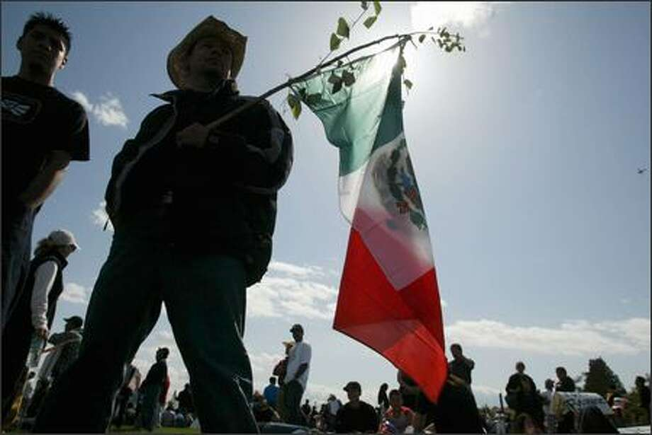 Marcos Gonzalez of Jalisco, Mexico, waits for a protest to begin at Judkins Park during an immigrant rights rally in Seattle. Photo: Joshua Trujillo, Seattlepi.com