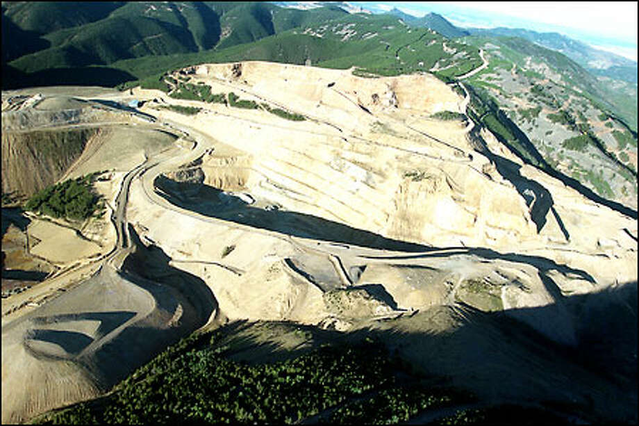 Heap-leach mining of gold on land that was once part of the Fort Belknap Indian Reservation in northern Montana has left the Little Rockies scarred and the reservation's water fouled. Tens of thousands of abandoned mines taint the landscape across the West. Photo: Gilbert W. Arias, Seattle Post-Intelligencer