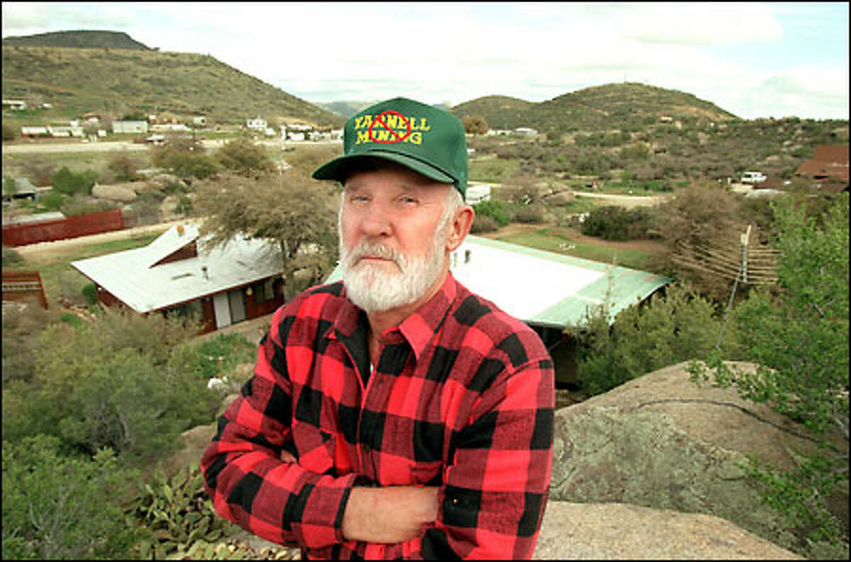 ARIZONA IN THE BLAST ZONE, Bill Ashworth, one of the many retirees living in Yarnell, Ariz., says that if Bema Gold Inc. is allowed to begin mining a site on Weaver Mountain behind him, residents will be forced to evacuate.