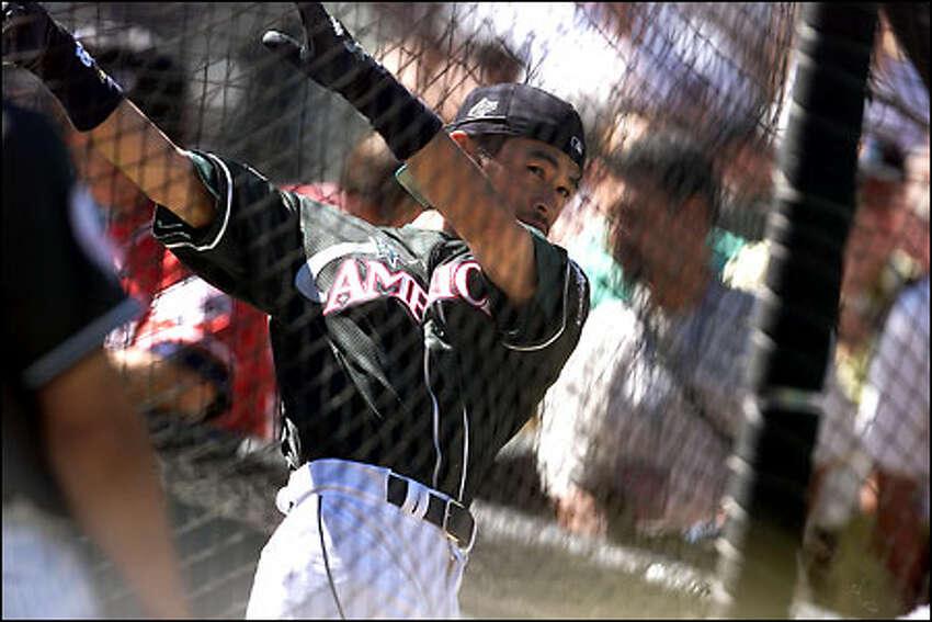 Ichiro takes his turn a batting practice.