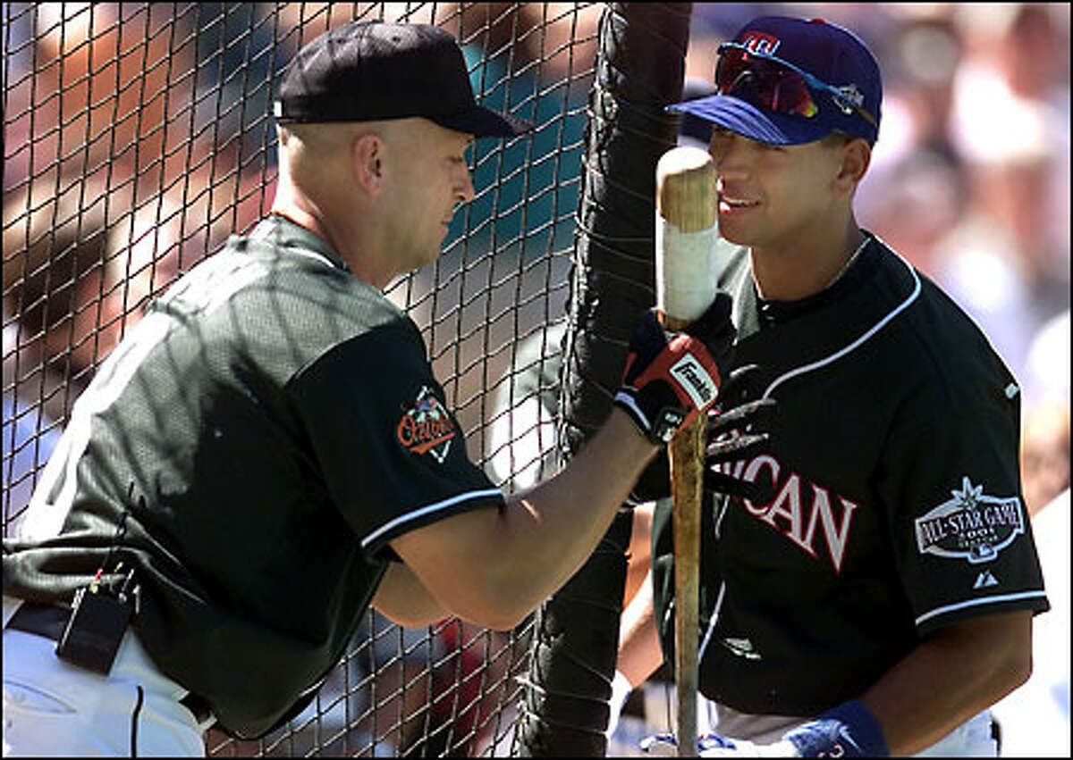Cal Ripken Jr. and Alex Rodriguez chat during batting practice.