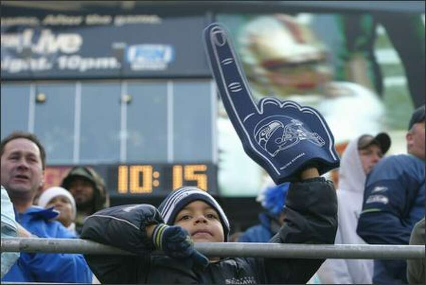 Seahawks fan Zyion Handburgh, 6, cheers the team on during the game against San Francisco.