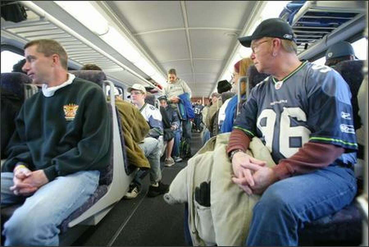 It's standing room only on the Sounder train as Seahawks fans head up from the south end for Suday's game with San Francisco. From the left is Mark Brandewie, of Fircrest, and Lonnie Calhoun, of Bonnie Lake.