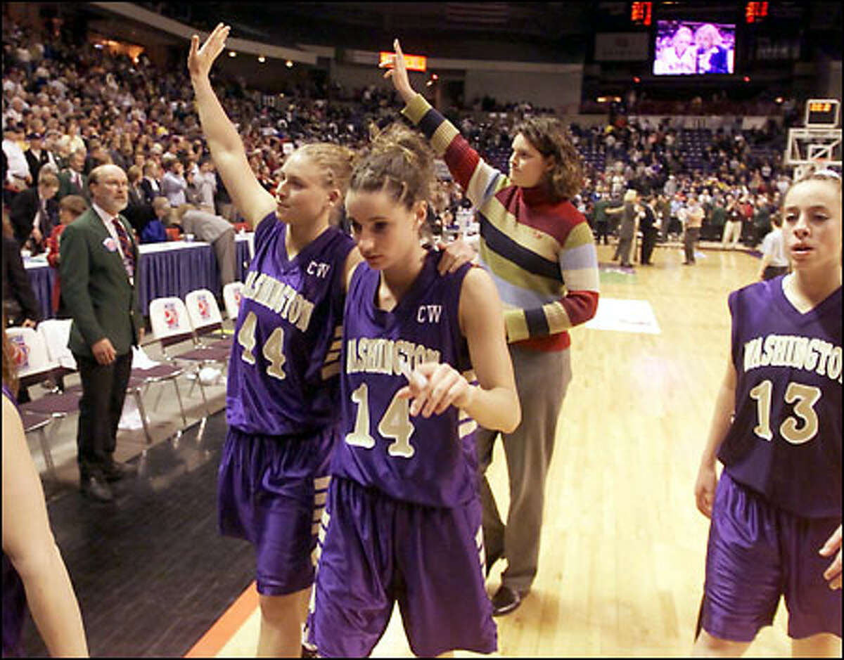 Washington's Cheryl Sorenson (44), Megan Franza (14) and Giuliana Mendiola (13) leave the court with heads held high after the Huskies' loss in the NCAA West regional final.