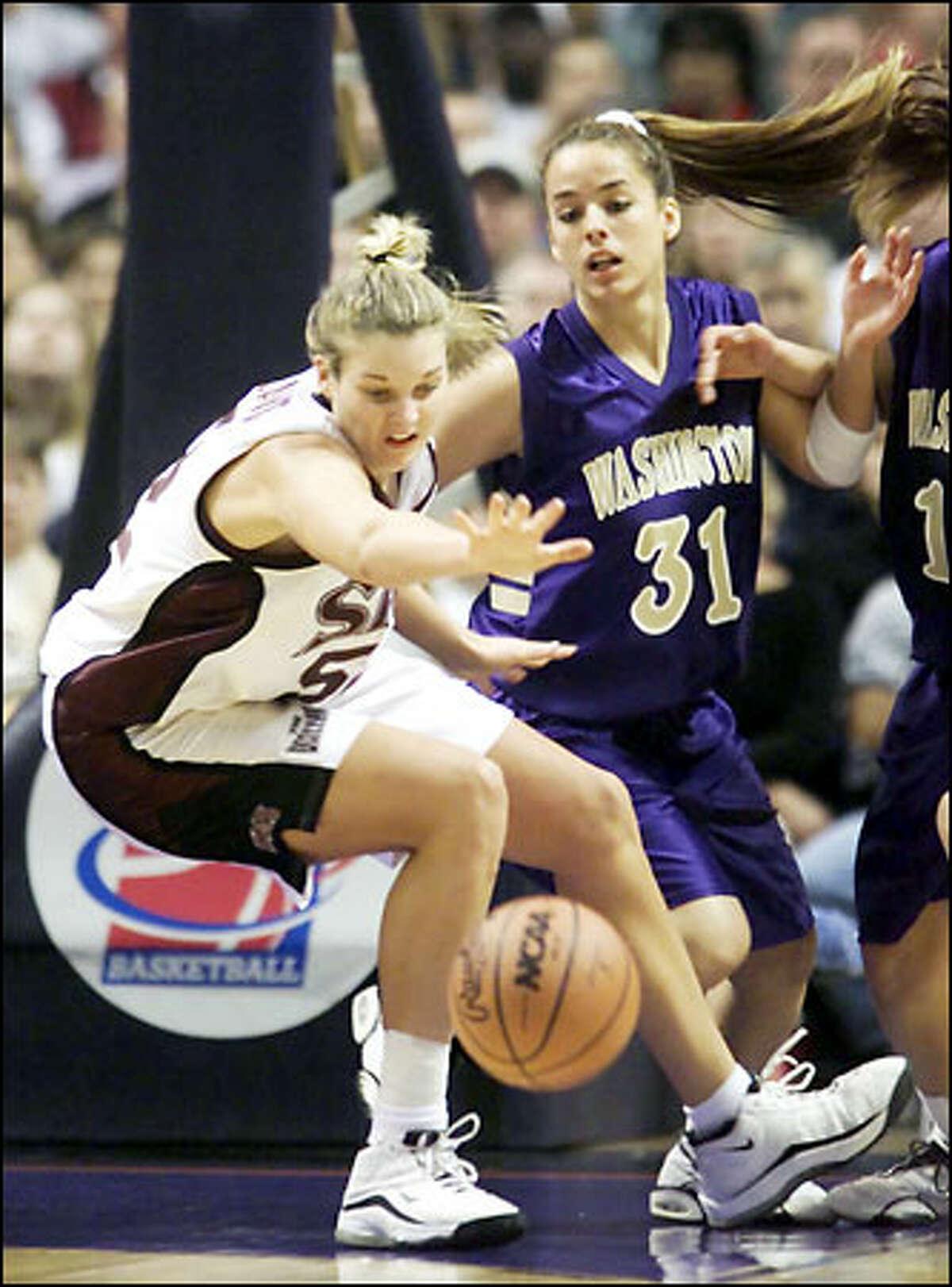 Washington freshman guard Gioconda Mendiola tips the ball away from Southwest Missouri State's Ann Cavey.