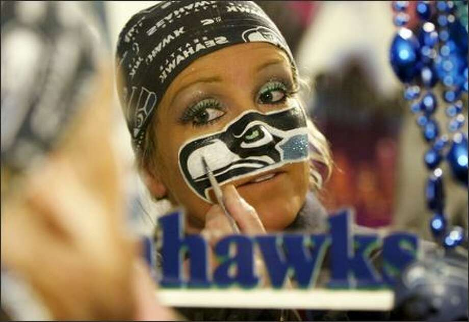DeDe Schumaier, aka Mrs. Seahawk, starts painting her face at 4 a.m. for a 1 p.m. game against the St. Louis Rams. Photo: Dan DeLong, Seattle Post-Intelligencer