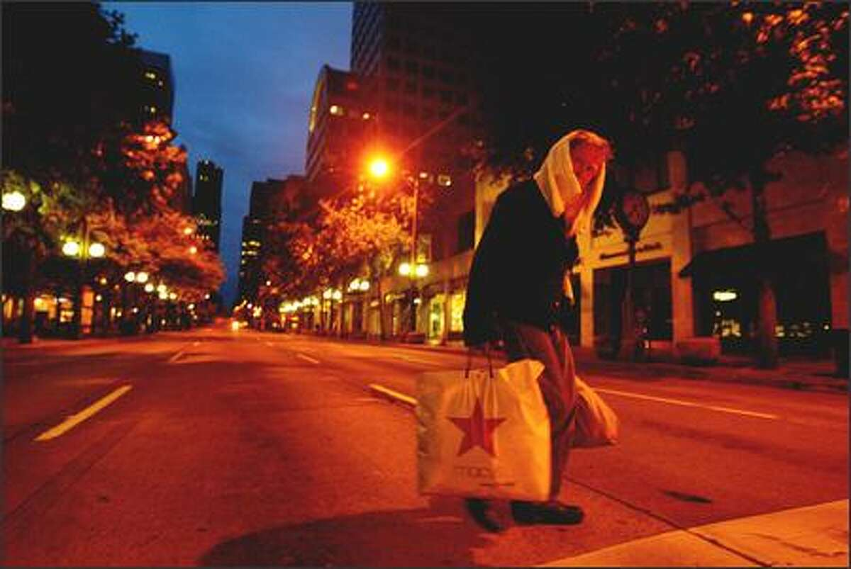 4:35 a.m. -- With the first light of the longest day of the year, a homeless man crosses Third Avenue at Westlake Park on Wednesday.