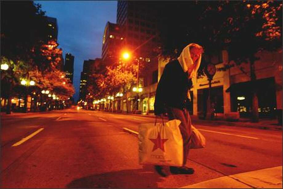 4:35 a.m. –- With the first light of the longest day of the year, a homeless man crosses Third Avenue at Westlake Park on Wednesday. Photo: Paul Joseph Brown, Seattle Post-Intelligencer