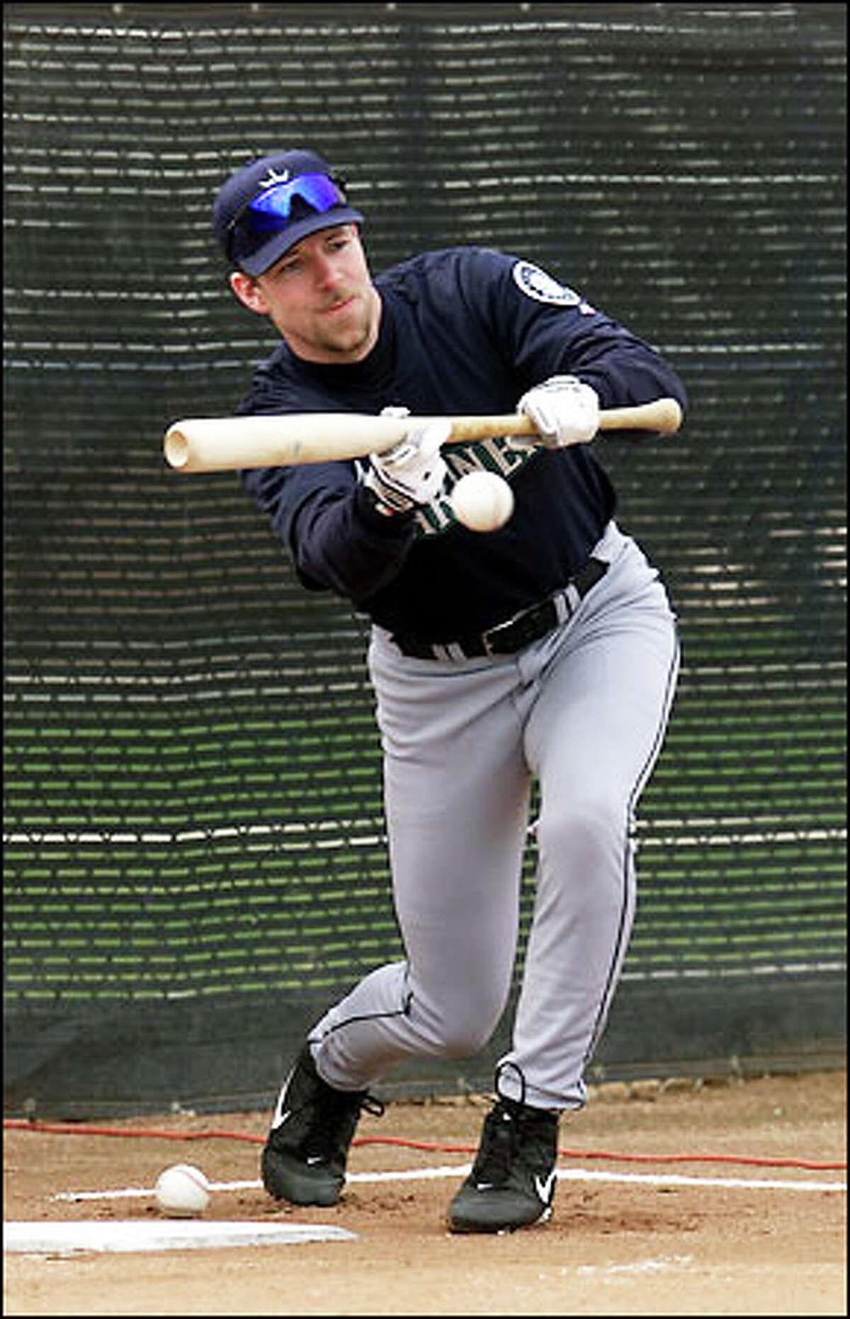 Catcher Chris Widger practices his bunting.