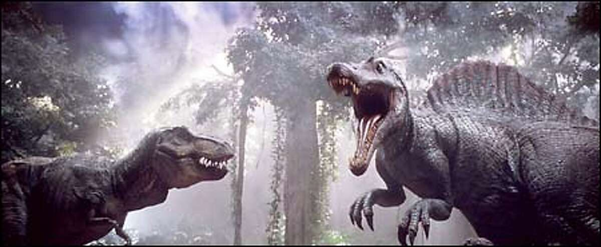 Tyrannosaurus Rex, left, faces off against an even more aggressive opponent, the Spinosaurus.