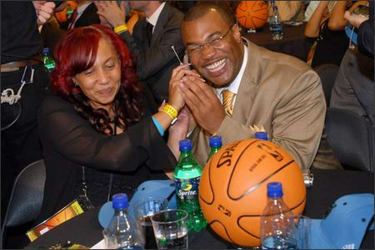 The parents of Brandon Roy, mother Gina, left, and father Tony are overcome by emotion after their son was picked in the sixth position by Minnesota. He was later traded to Portland.