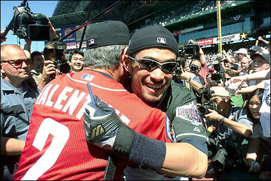 Ichiro gets a hug from National League manager Bobby Valentine during pregame autograph session at Safeco Field. Photo: Dan DeLong, Seattle Post-Intelligencer