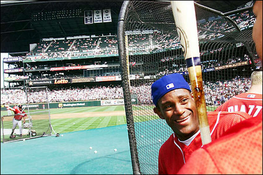 Sammy Sosa chats with friends during batting practice at Safeco Field prior to the start of the All Star Game.