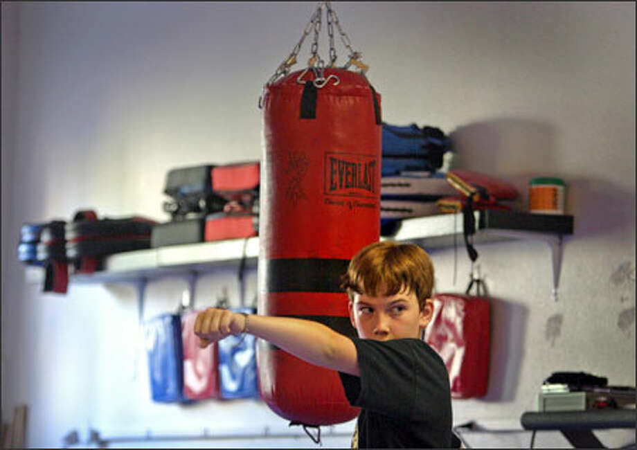 Hunter Fulton, 11, practices his karate routine yesterday at Alpha Martial Arts in the Green Lake neighborhood. Hunter also has Type 1 diabetes and is in clinical trials to help with his illness. Photo: Joshua Trujillo/Seattle Post-Intelligencer / Seattle Post-Intelligencer