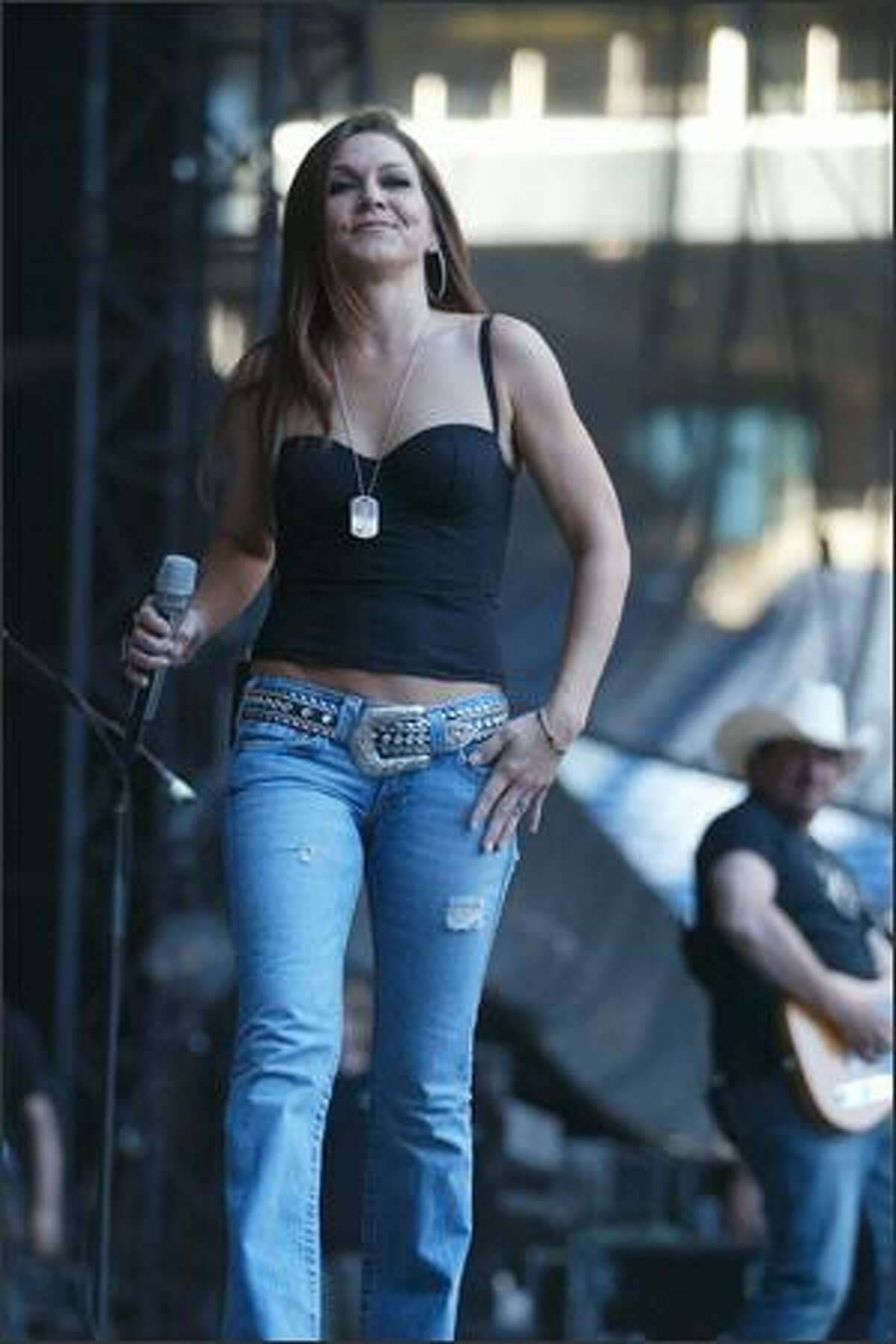 Gretchen Wilson arrives on stage to begin her performance at Qwest Field Saturday evening.