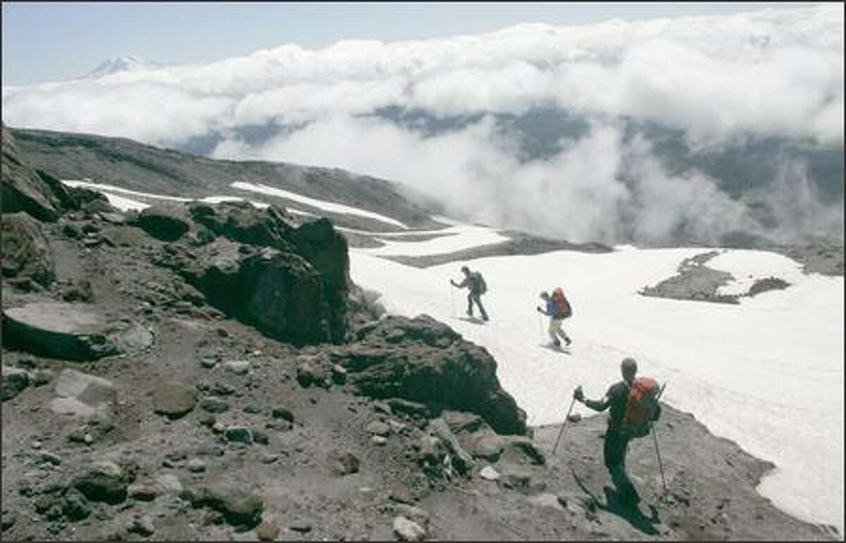 Media representatives join U.S. Forest Service Climbing Rangers on a hike to the rim of Mount St. Helens on Thursday. The climb will soon be open to the public after having been closed since 2004 due to volcanic activity.