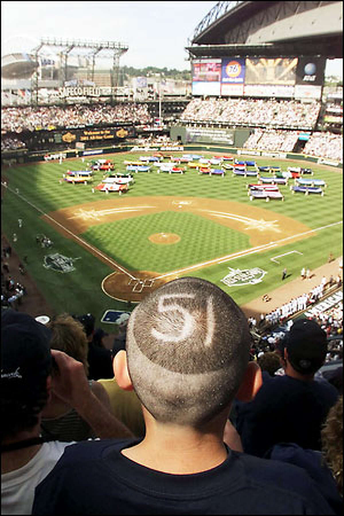With Ichiro Suzuki's number shaved into his head, Matthew Bonime, 12, of Seattle, watches the opening ceremonies of the All-Star Game. He is sitting on the 300 level directly behind home plate.