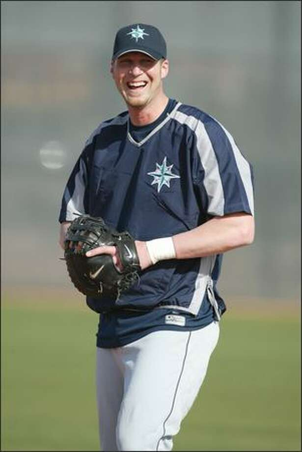 First baseman Richie Sexson seemed happy to be back at spring training as he fielded ground balls at the first full squad workout. Photo: Scott Eklund, Seattle Post-Intelligencer