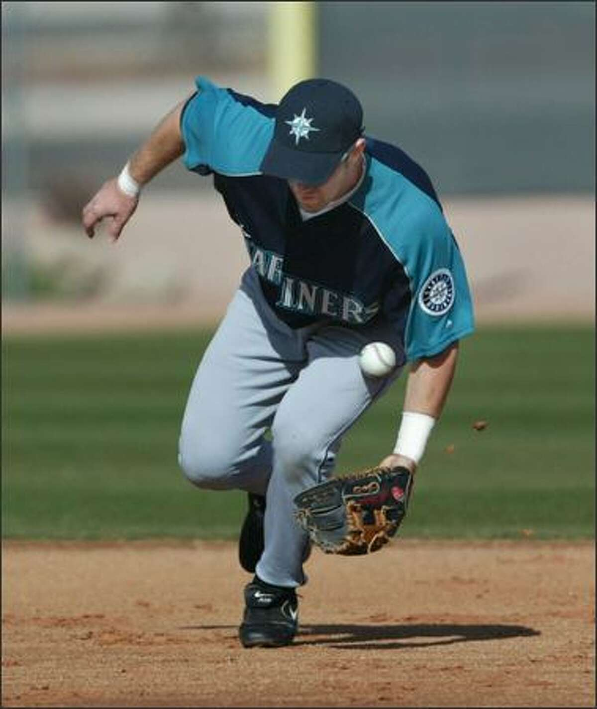 A hard infield caused some interesting hops as Willie Bloomquist found out while taking ground balls at shortstop.
