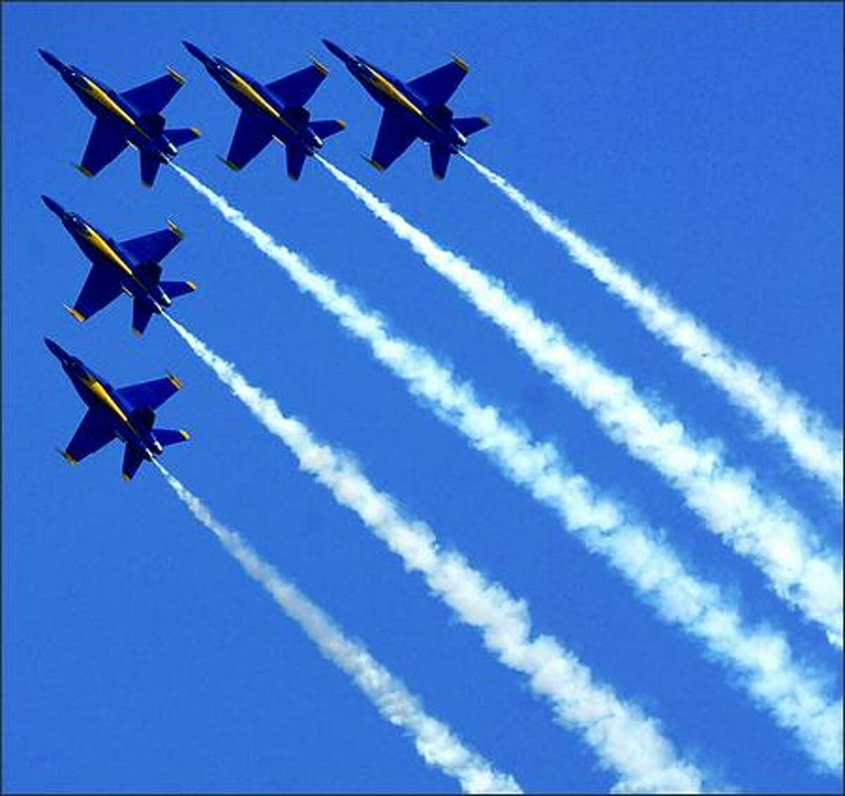 The Blue Angels make a practice run over Lake Washington.