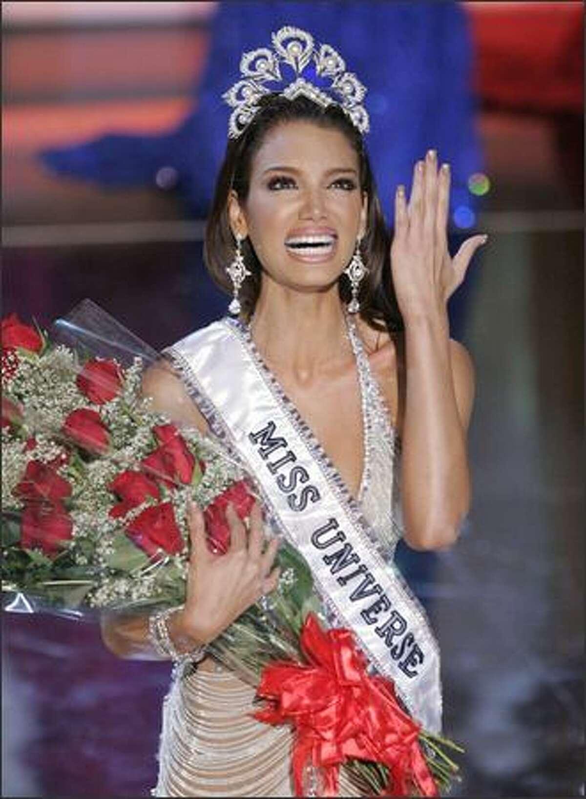 Zuleyka Rivera Mendoza, Miss Puerto Rico, reacts after being crowned Miss Universe 2006. (AP Photo/Mark J. Terrill)