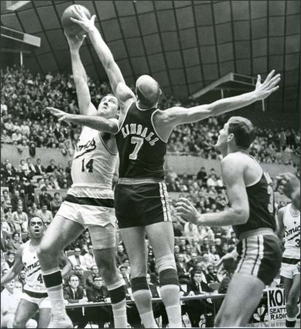 1967: Seattle SuperSonics player Tom Meschery shoots against San Diego.
